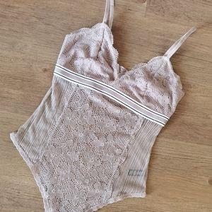 Dynamite blush pink sheer lace bodysuit